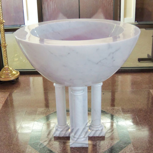 Bright White Marble Font in a Church on Stock